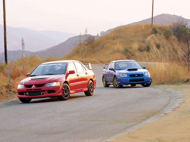 a comparison of mitsubishi lancer evolution viii and subaru impreza wrx Not a comparison test: mitsubishi lancer evo vs subaru wrx sti as companions for fast driving on rainy days, and a reason to argue, few.